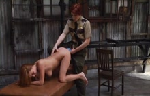 Redhead lesbian cop strapon fucks a prisoner