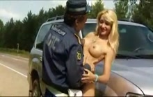 Policeman having fun with a kinky blonde