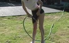 Schoolgirl watering her muff