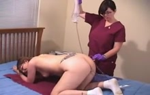 Nurse filling her hole with liquid