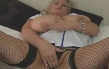 Obese nurse playing with her pussy